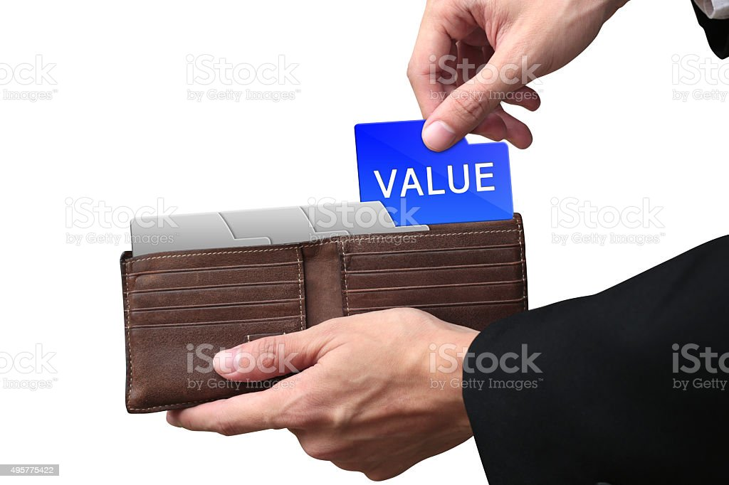 Businessman hands pulling money VALUE concept on brown wallet. stock photo
