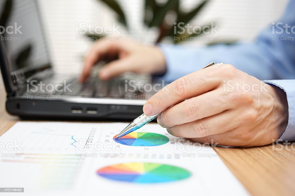 businessman hands reviewing business report stock photo