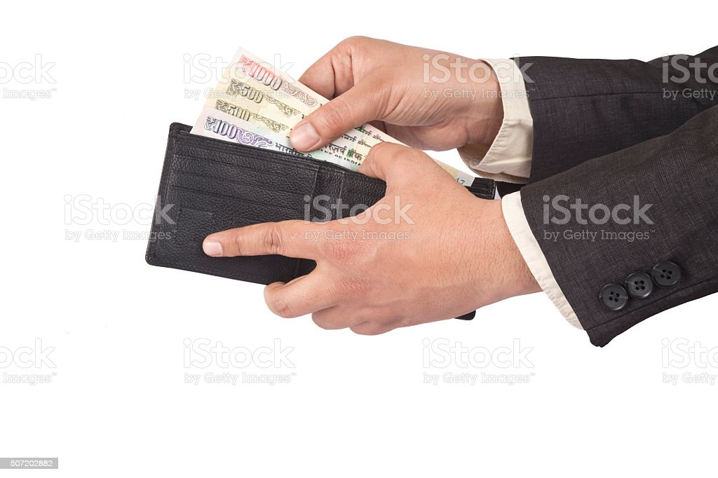 Businessman hands to get money from his wallet stock photo