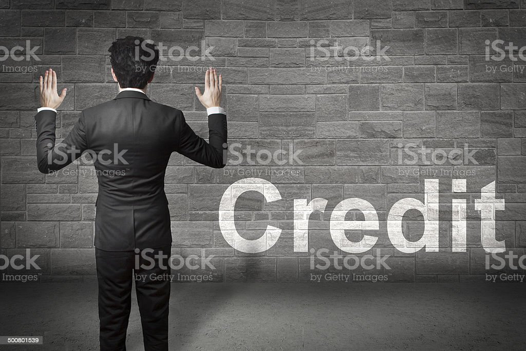 businessman hands up wall credit stock photo
