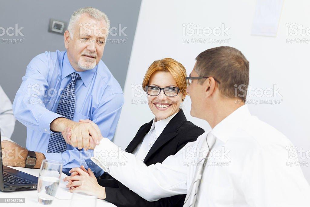 Businessman handshaking with partner royalty-free stock photo