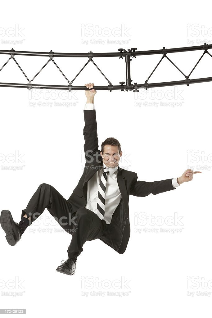 Businessman hanging with a metal structure royalty-free stock photo