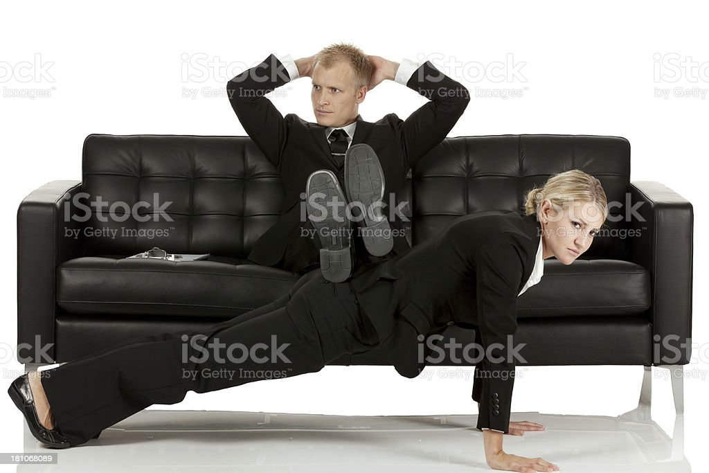 Businessman harassing businesswoman stock photo
