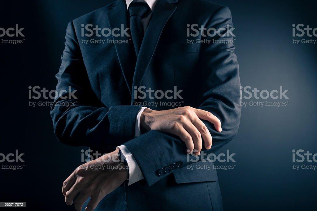 Businessman has arm pain stock photo