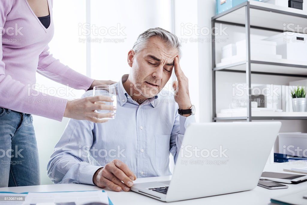 Businessman having an headache stock photo
