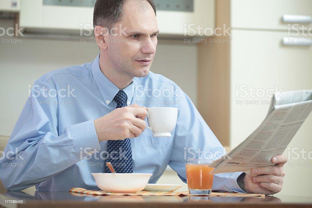 Businessman having breakfast royalty-free stock photo
