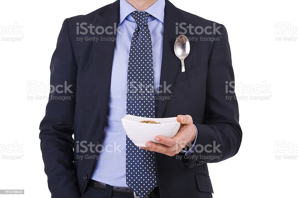 Businessman having breakfast with cereal bowl. royalty-free stock photo