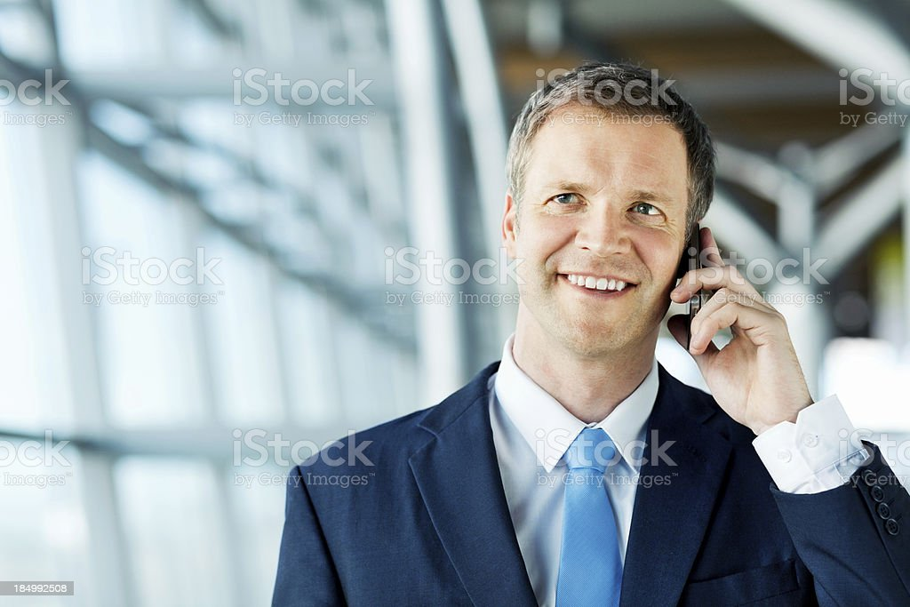 Businessman Having Conversation On Cell Phone At Airport royalty-free stock photo