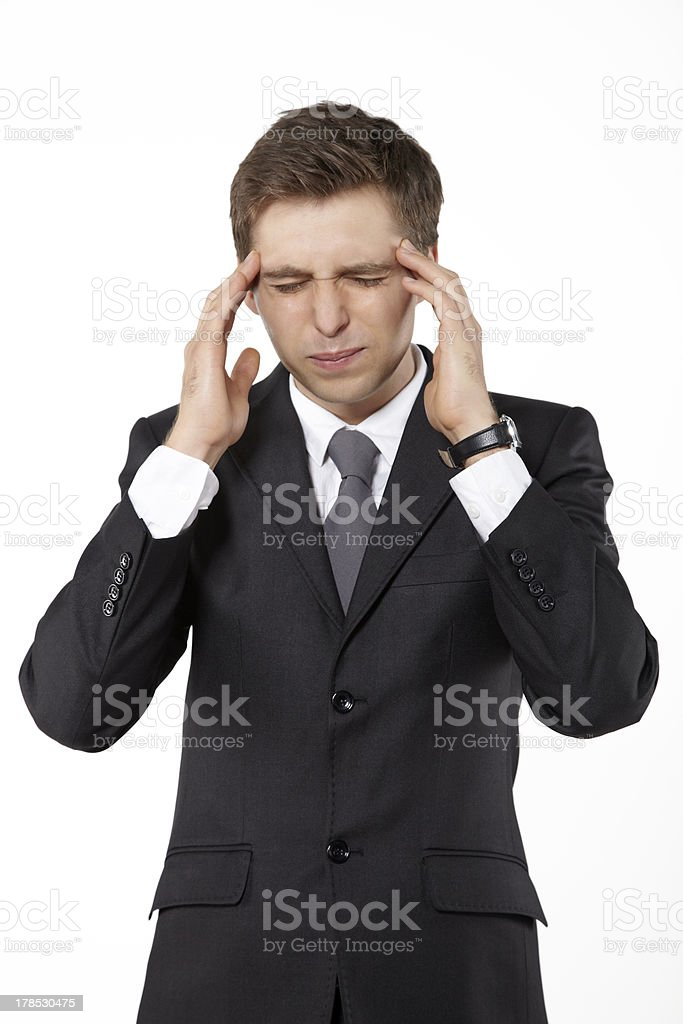 Businessman having headache. stock photo