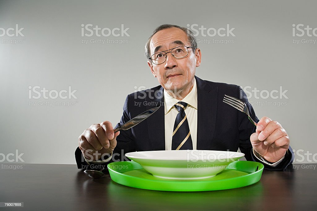 A businessman having his dinner at his desk royalty-free stock photo