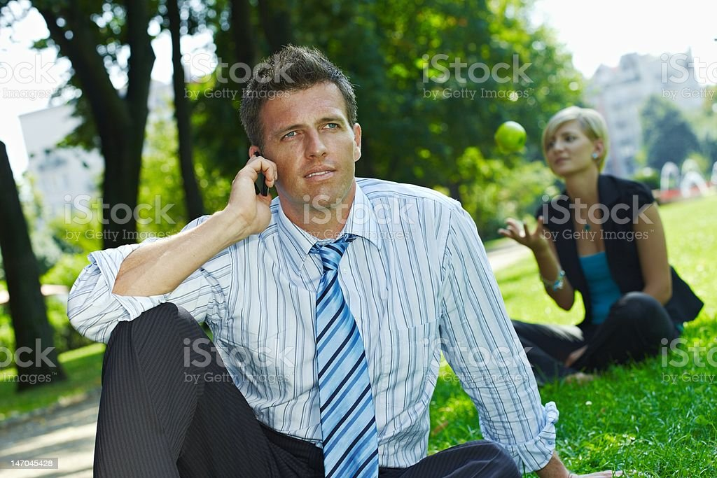 Businessman having lunch break in park royalty-free stock photo