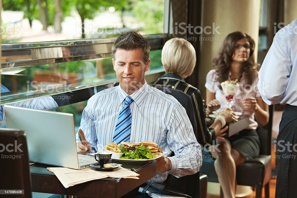 Businessman having lunch in cafe royalty-free stock photo
