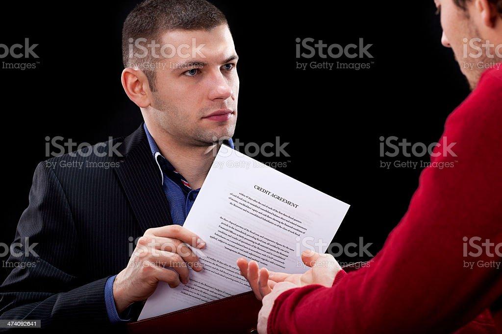 Businessman hidding unfair contract stock photo