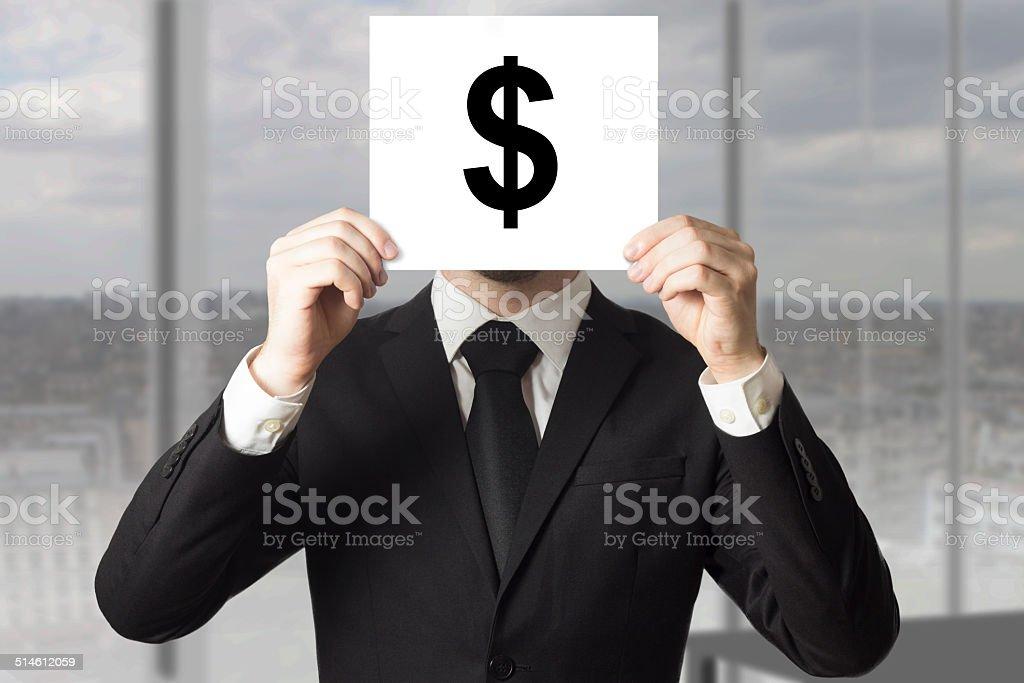 businessman hiding face behind sign dollar symbol stock photo