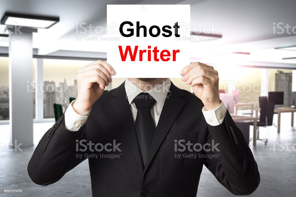 businessman hiding face behind sign ghost writer stock photo