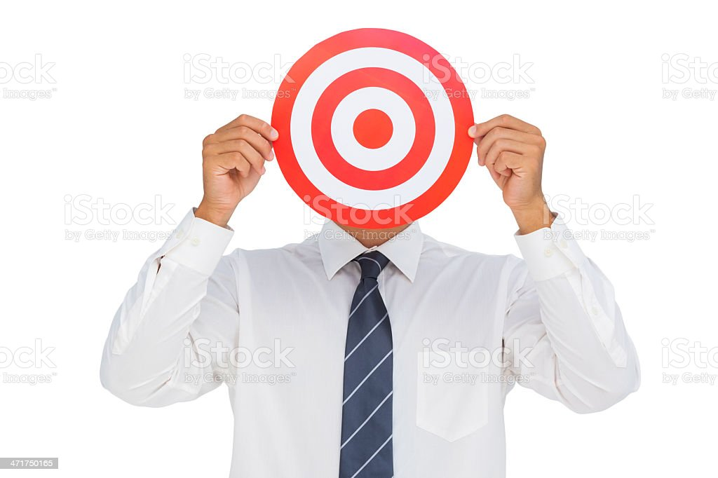 Businessman hiding his face behind a red bulls eye royalty-free stock photo