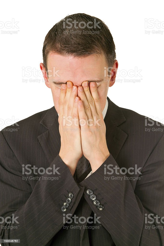 Businessman hiding his face in shame royalty-free stock photo