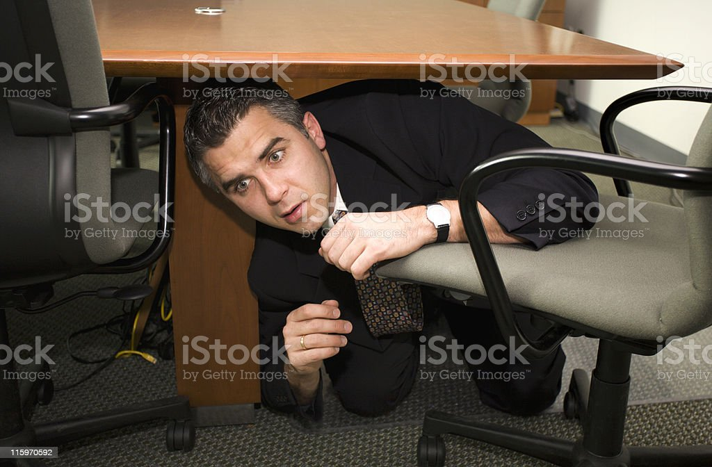 Businessman hiding stock photo