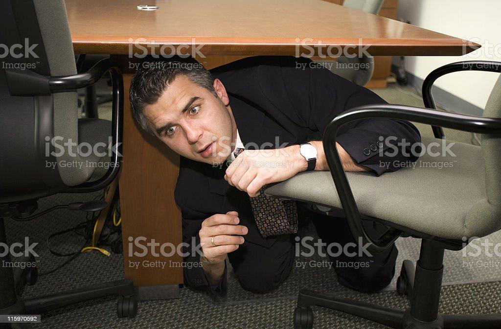 Businessman hiding stock photo