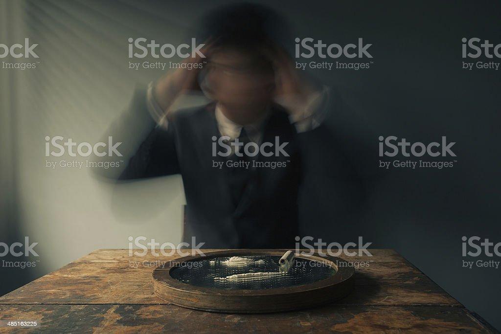 Businessman high on cocaine royalty-free stock photo