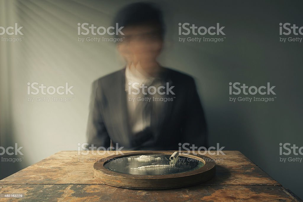 Businessman high on cocaine royalty-free stock photo