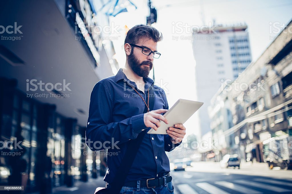 Businessman hipster working on tablet stock photo