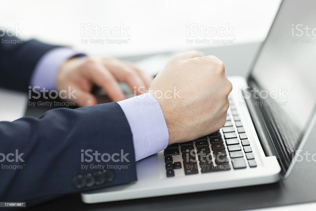 Businessman hitting laptop with his fist royalty-free stock photo