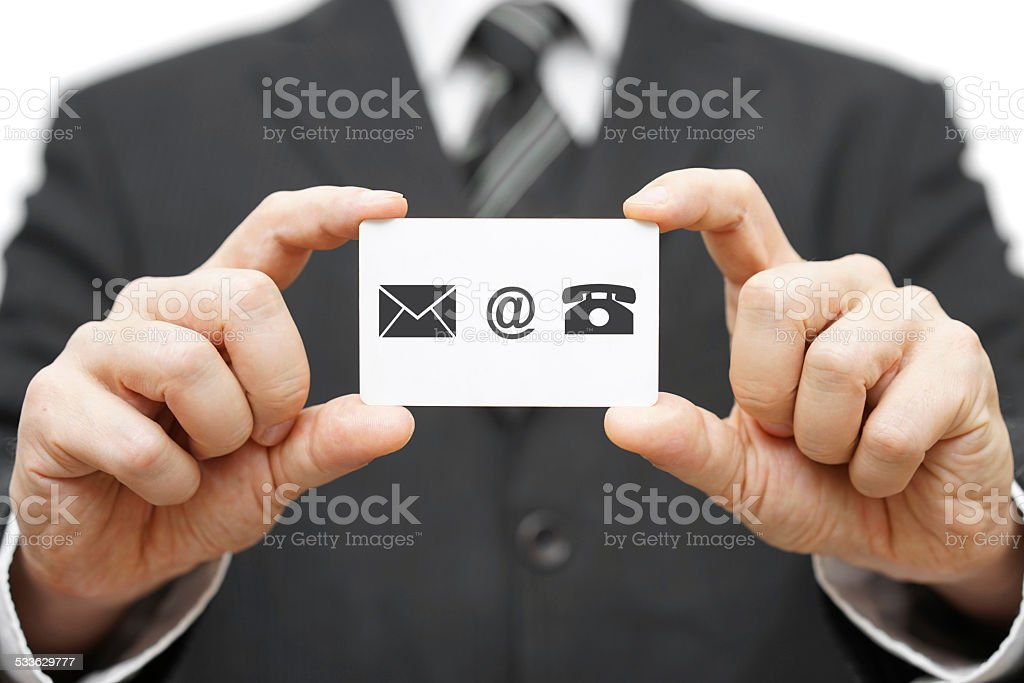 businessman hold business card with email,mail, phone icon. stock photo