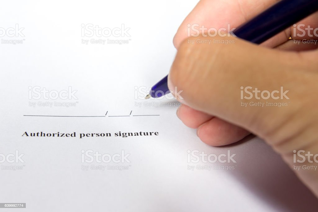 Businessman hold pen for sign in authorization signature stock photo