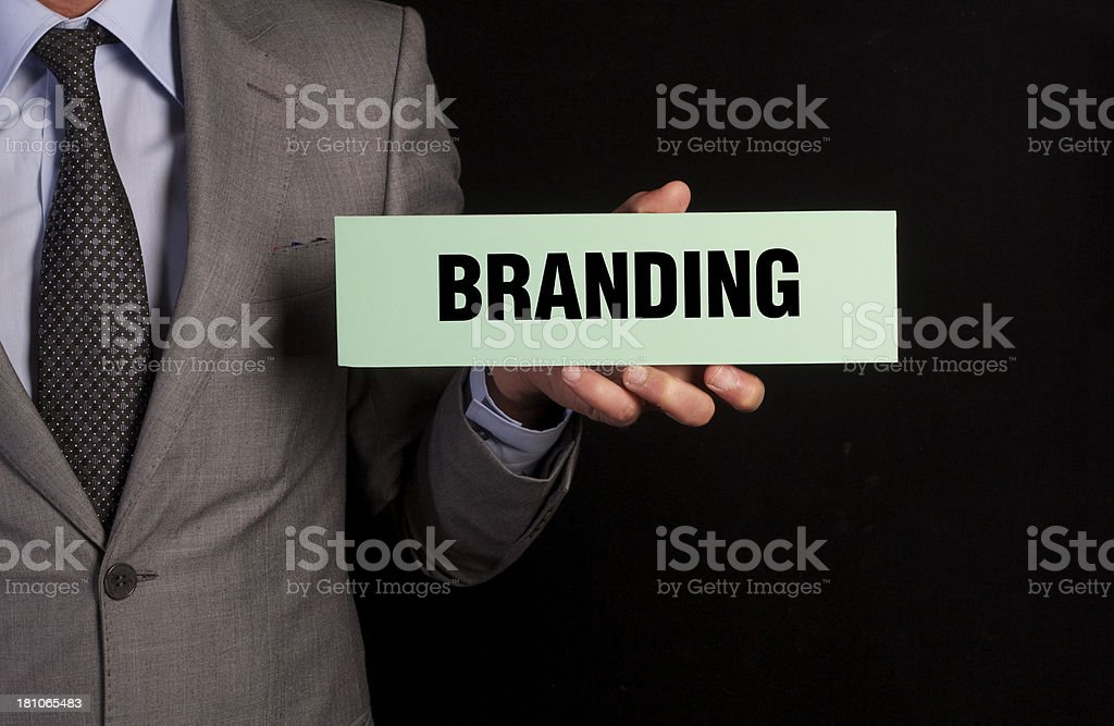 Businessman Hold Placard with Branding Message stock photo