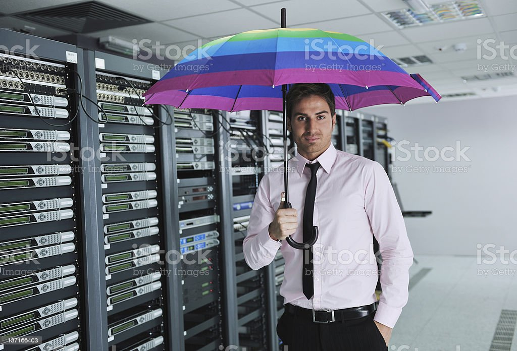 businessman hold umbrella in server room royalty-free stock photo