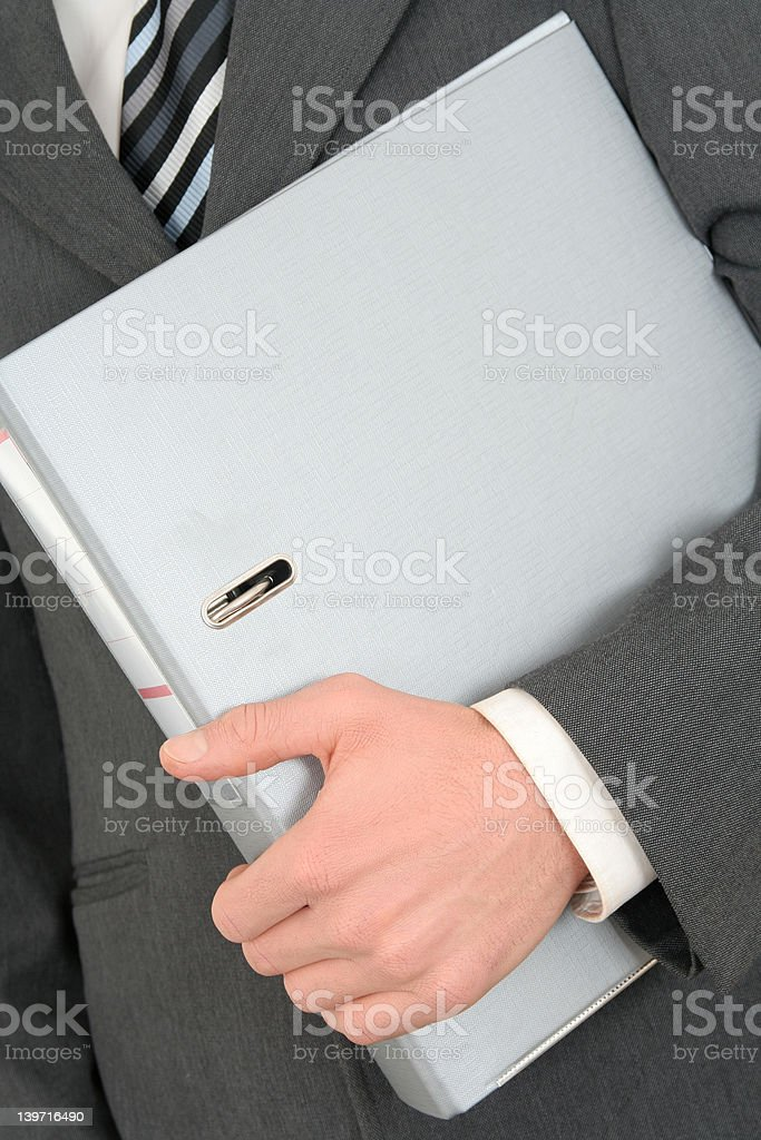 Businessman Holding a Binder royalty-free stock photo