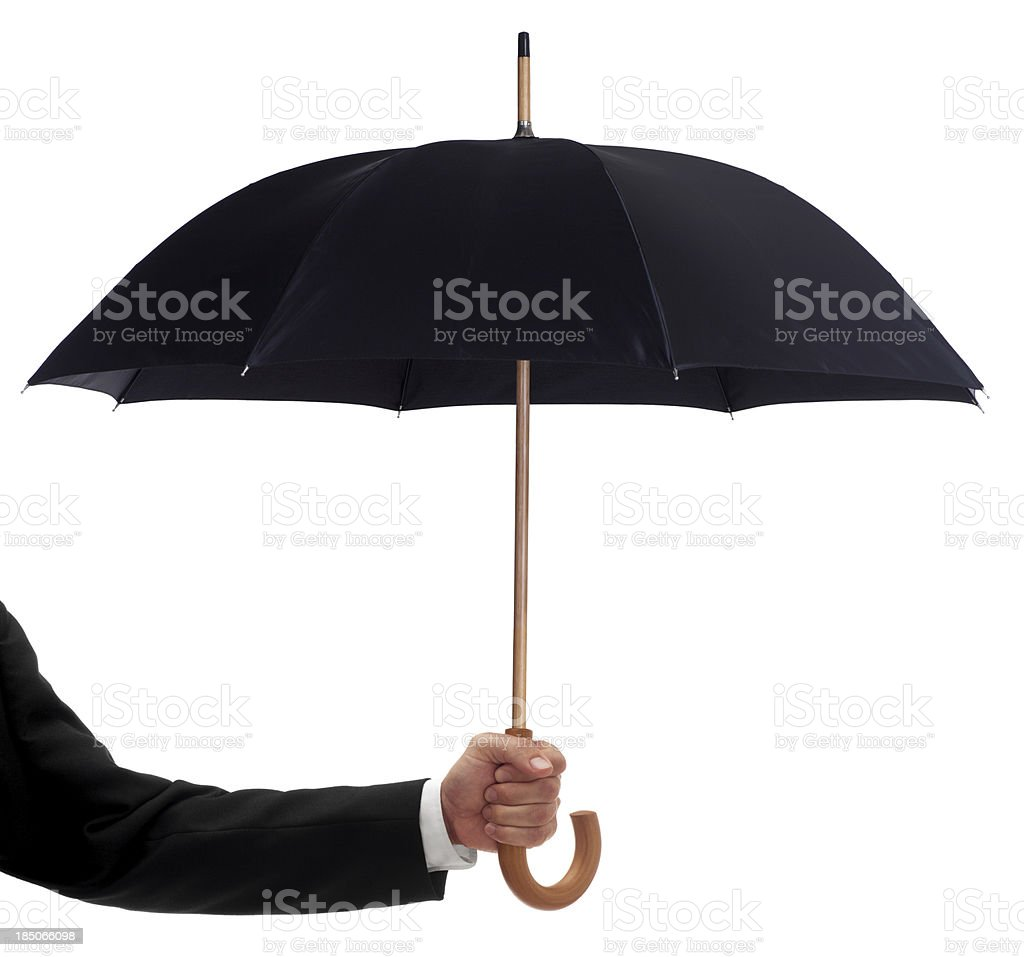 Businessman Holding a Black Umbrella stock photo