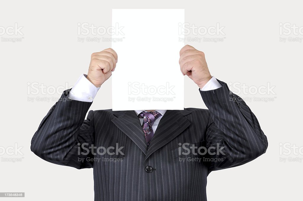Businessman holding a blank paper royalty-free stock photo