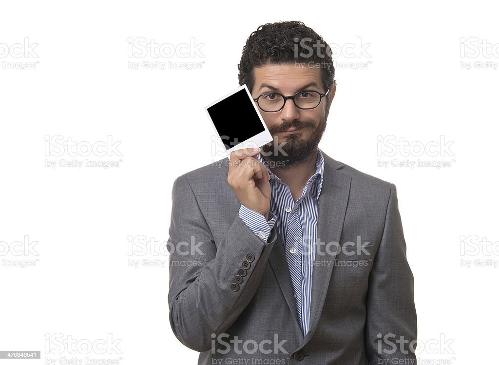 Businessman holding a blank picture frame stock photo
