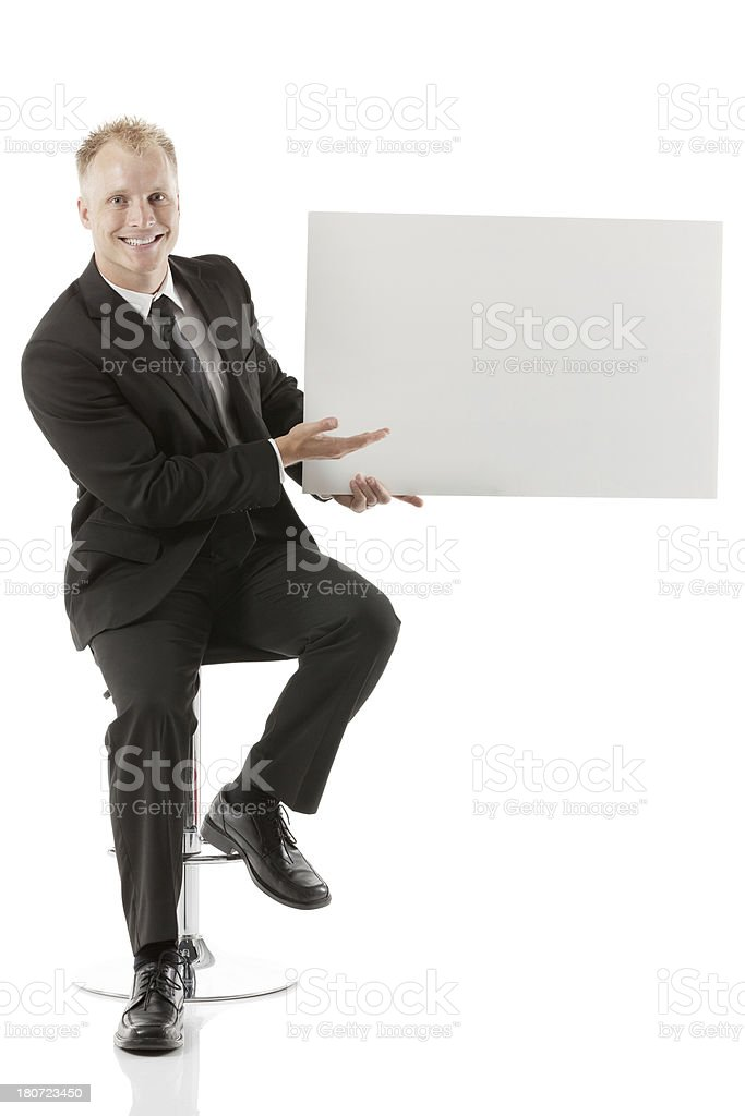 Businessman holding a blank placard royalty-free stock photo