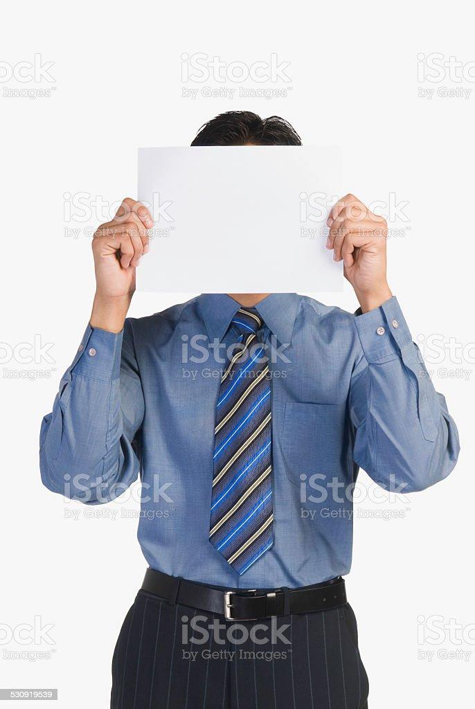 Businessman holding a blank placard stock photo