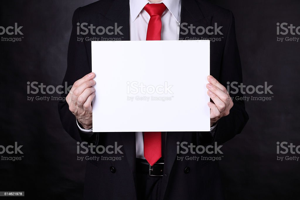 Businessman holding a blank sign stock photo