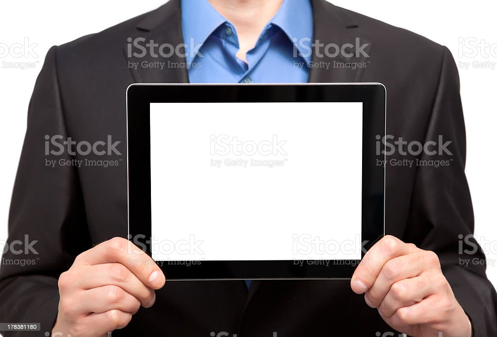 Businessman holding a blank tablet stock photo