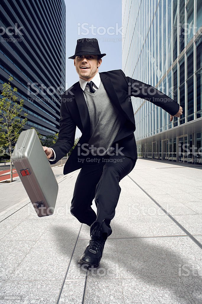 A businessman holding a briefcase stock photo