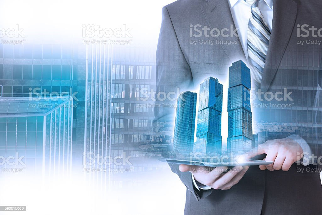 businessman holding a building, skyscraper stock photo
