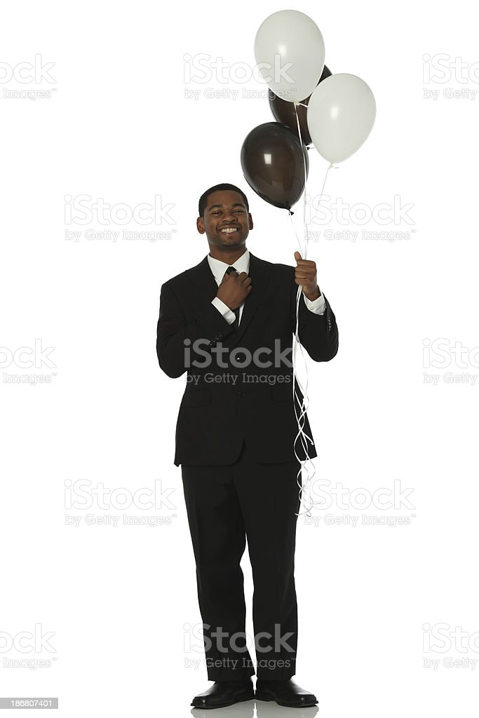 Businessman holding a bunch of balloons royalty-free stock photo