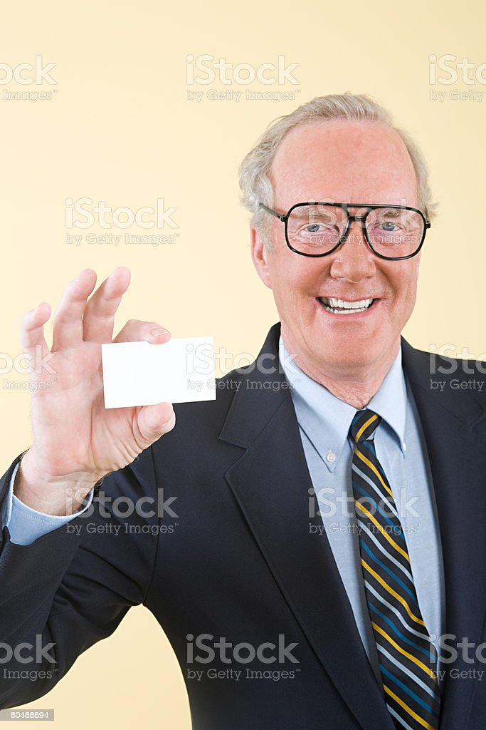 A businessman holding a business card stock photo
