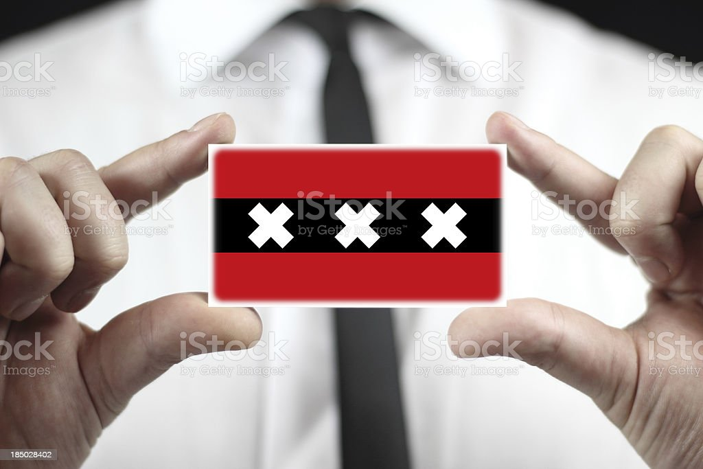 Businessman holding a business card with Amsterdam City Flag royalty-free stock photo