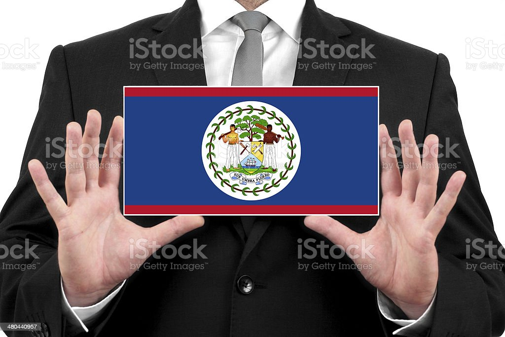 Businessman holding a business card with Belize Flag stock photo