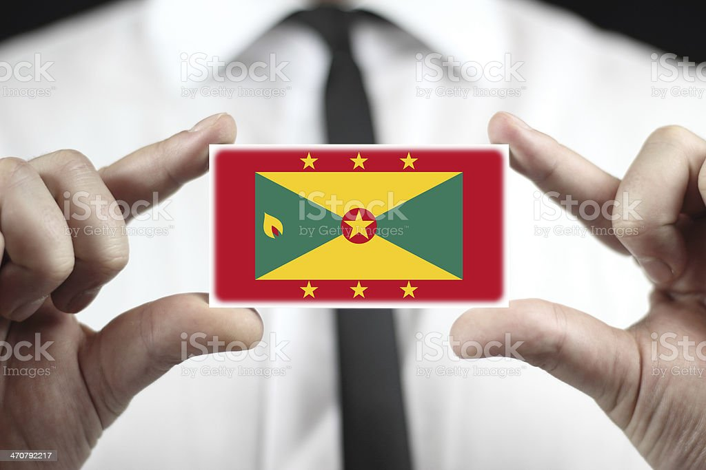 Businessman holding a business card with Grenada Flag stock photo