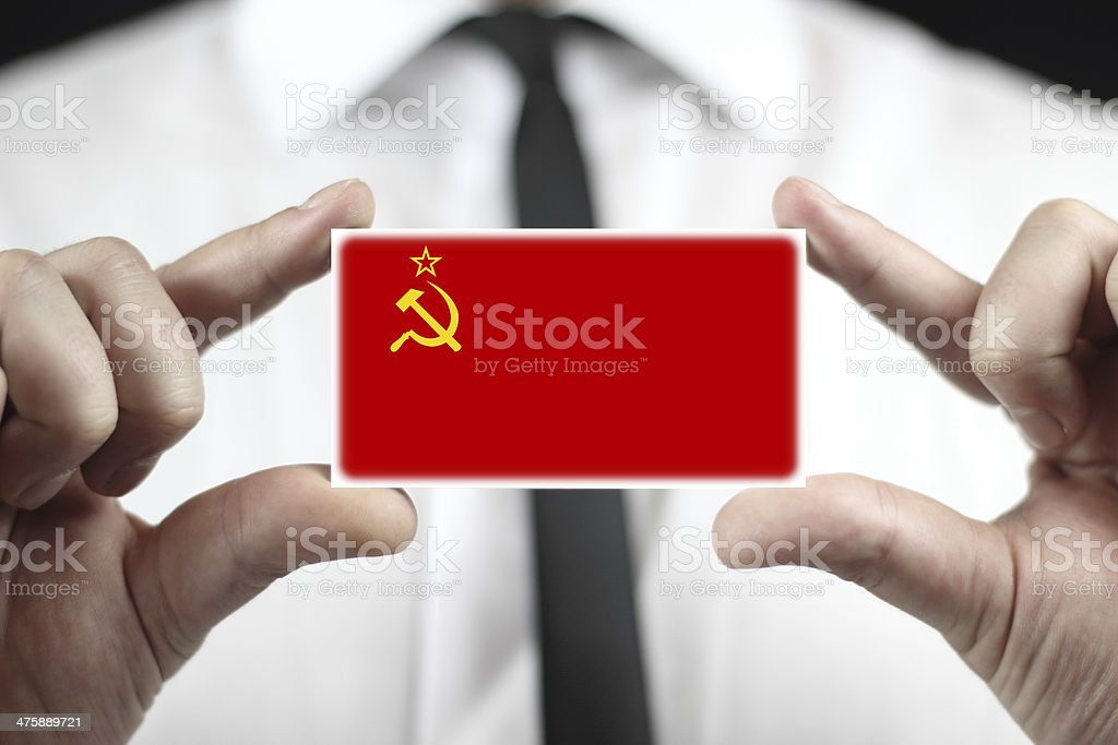 Businessman holding a business card with USSR Flag royalty-free stock photo