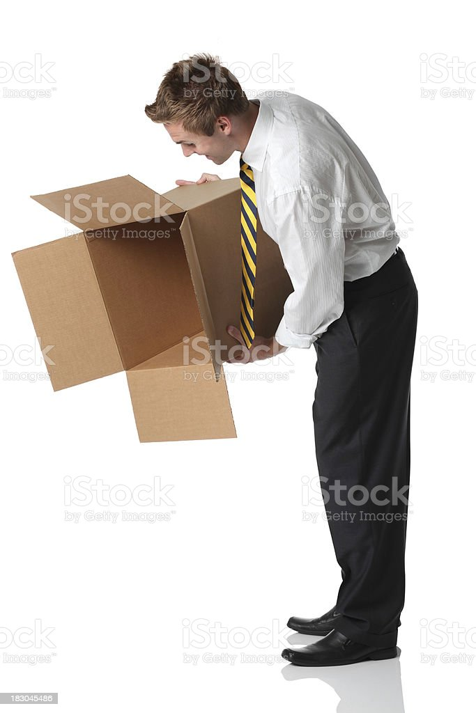 Businessman holding a cardboard box stock photo