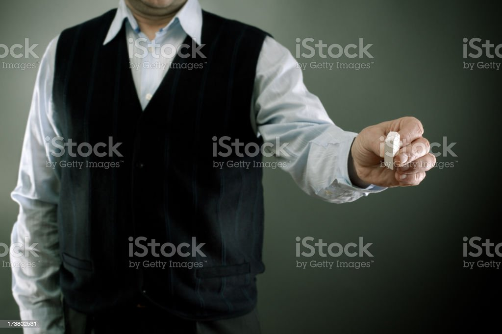 Businessman holding a chalk royalty-free stock photo