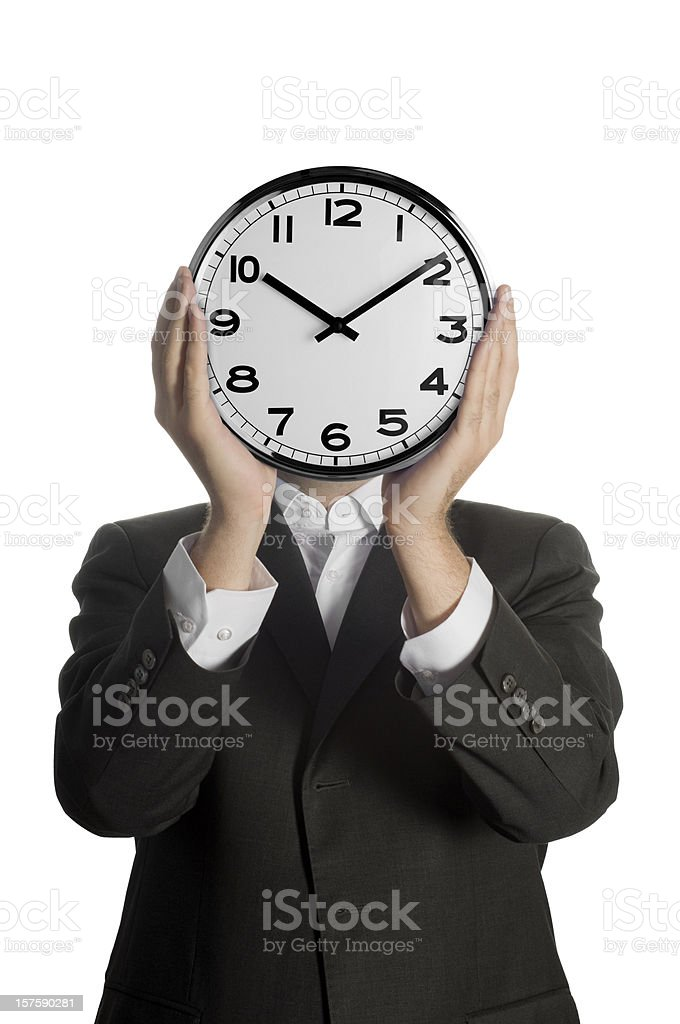 Businessman holding a clock in front of his face royalty-free stock photo